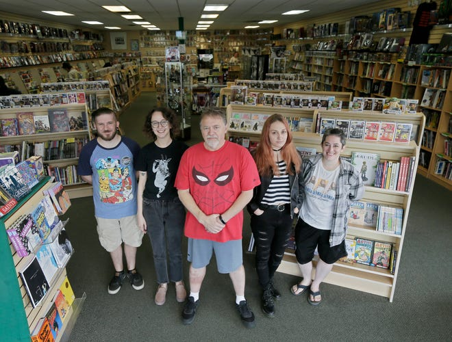 Laughing Ogre at 4258 N. High St. won a prestigious Eisner award, which goes to one comic book store in the world every year. Store owner Gib Bickel, center, with store managers Andrew Burgess, from left, Lauren McCallister, Trish Smith and Sarah Edington.