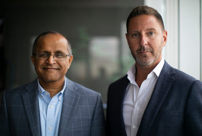Giri Devanur, left, CEO of the Dublin startup ReAlpha, with one of ReAlpha's largest investors, Brent Crawford, a partner in the Dublin development firm Crawford Hoying.