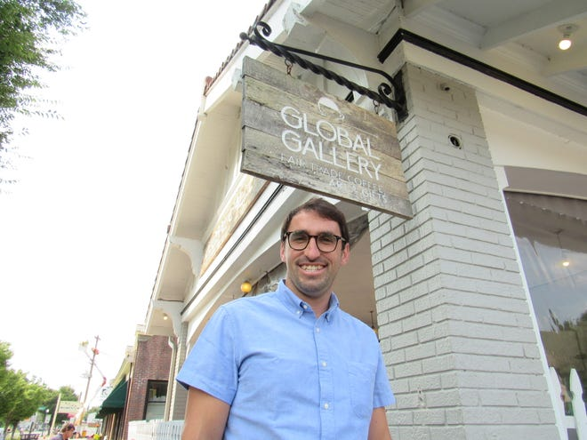 Ryan Deeter stands in front of Global Gallery in Clintonville. Deeter is president of the newly formed Clintonville Area Business Association, which is filling the void of the disbanded Clintonville Area Chamber of Commerce.