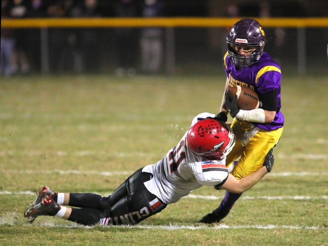 Clinton's Davey Campbell tackles Blissfield's Kevin Ybarra during the 2020-21 playoffs. [Telegram photo by John Discher]