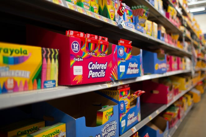 July 2021 file photo of school supplies stocked on the shelves of a Walmart Supercenter.