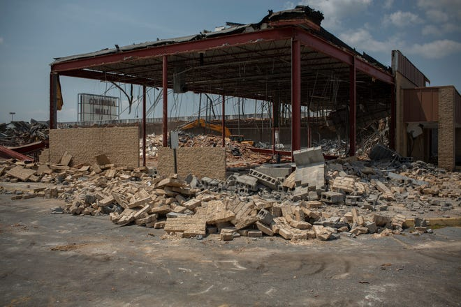 Demolition of the former JCPenney department store continues at the Columbia Mall in Columbia, Tenn., on Wednesday, July 28, 2021.