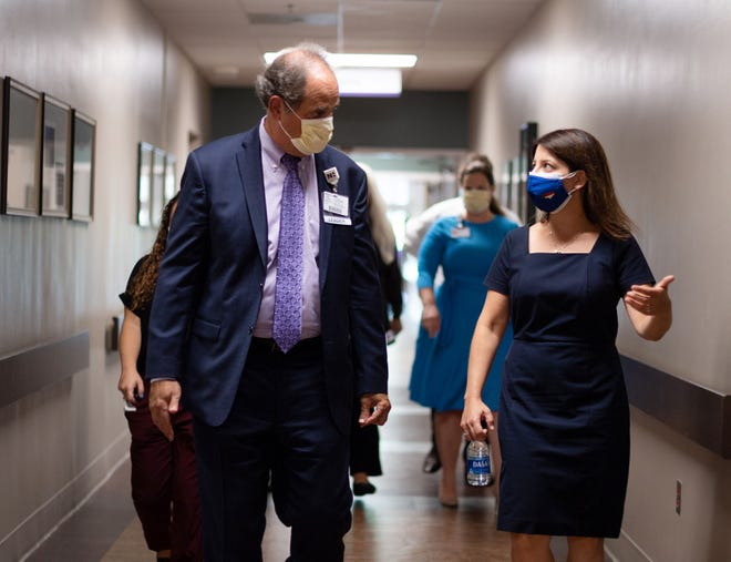 Jon Applebaum, president and COO at Novant Health Thomasville Medical Center, has a discussion with N.C. Secretary of Health Mandy Cohen during her visit on Tuesday.
