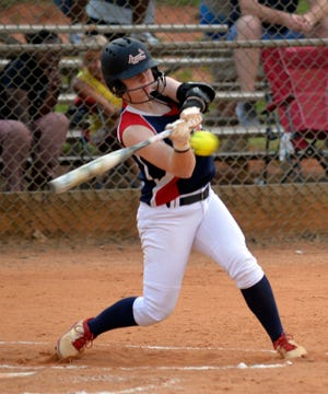 Davidson County's Allie Johnston starts her swing on a two-run homer against Mint Hill in Game 2 of the American Legion Area III softball championship on Tuesday. [Mike Duprez/The Dispatch]