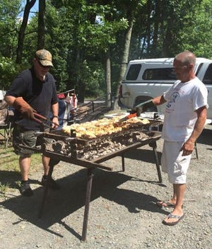 Bill Lukacinsky (left) and Mike Liftcuss man the grill at a past flea market chicken barbecue. /Contributed image