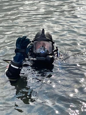 Tafton Dive Team Captain Rich Groo surfaces in Lake Wallenpaupack, July 17, 2021 with the FOURTH wedding ring he has recovered over the years. / Courtesy Tafton Dive Team