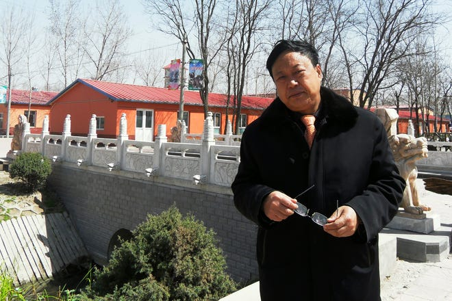 In this April 2, 2010 photo provided by the Legal Team of Dawu Group, Sun Dawu stands in Baoding in northern China's Hebei Province.