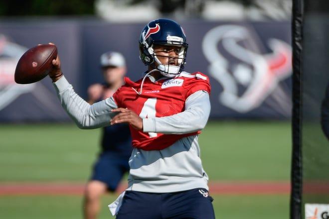 Houston Texans quarterback Deshaun Watson (4) throws the ball during NFL football practice Wednesday in Houston.