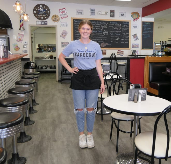 Kari Burge waits on customers at Blue Smoke Barbecue, which opens into the new Kuhn's Market, on Main Street in Hays, Kansas.