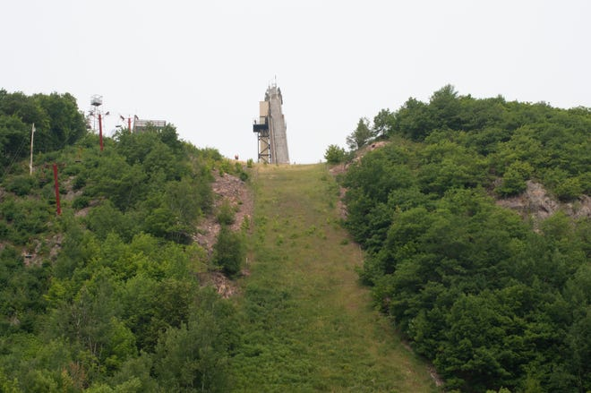 View from the bottom of the landing hill looking up at the Copper Peak Ski Jump. Directly left in red is the 800 foot chair lift to the base of the structure.