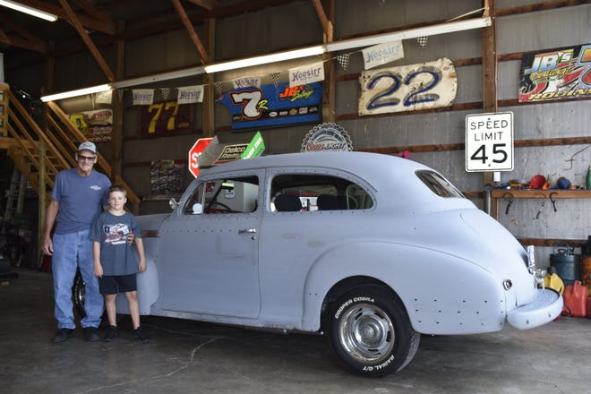Art Stevens and his 11-year-old grandson, Will, pose alongside the rebuilt 1941 Chevrolet Special Deluxe.