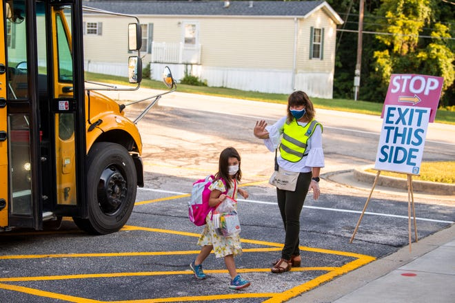 Principal Lily Albright welcomes kids to school in September 2020 at Unionville Elementary School.