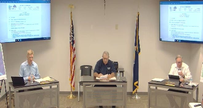 The Reno County Commission voted Tuesday to reduce commission salaries if voters approve expansion of the board.