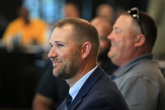Hutchinson Community College head football coach Drew Dallas smiles as he is introduced during the 2021 KJCCC Media Day event at Riverfront Stadium Wednesday afternoon.