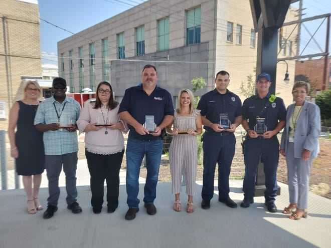 Massillon Mayor Kathy Catazaro-Perry and Safety-Service Director Barb Sylvester, far left, honored several employees during an award ceremony in Duncan Plaza. Among the awardees is retiring street Superintendent Lee McBride, who served more than 30 years; Community Development Director Samantha Walters, director of the year; Engineer Greg McCue, exemplary service award; Massillon Health Department Director of Nursing Audrey Sylvester, employee of the year; and firefighter/paramedics Isaac Hull and Mike Ramsey. Police office of the year Sgt. Josh Edwards was not present.