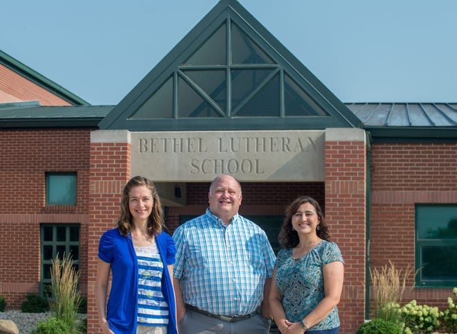 Principal John Jacob, middle, joins math teacher Karen Duke, left, and science teacher Emily Wegner outside Bethel Lutheran School, 325 E. Queenwood Road, Morton. The K-8 school has launched a new high school with five ninth-graders doing online and in-person learning.