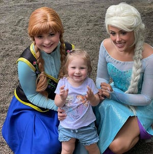 Anna and Elsa take a picture with a young Frozen fan during a Laurel's Princess Parties event. The popular Disney princesses are just two of nearly 30 characters that the company will offer for daily meet-and-greet events at the Monroe County Fair.
