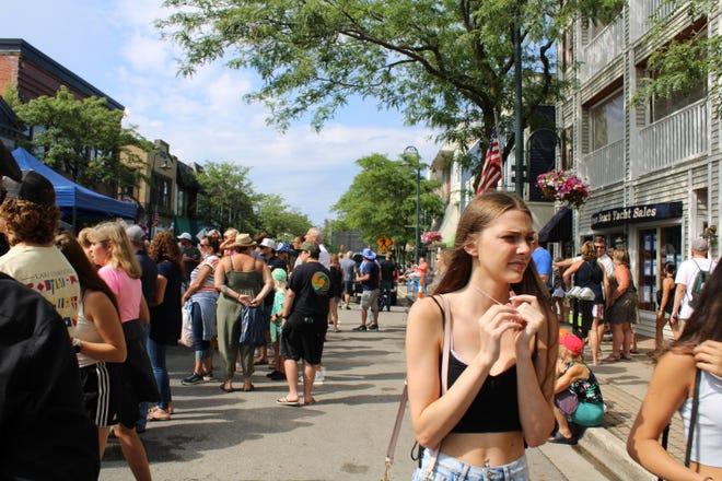 Folks congregated on Bridge Street on Saturday, July 24, for the annual Venetian Festival
