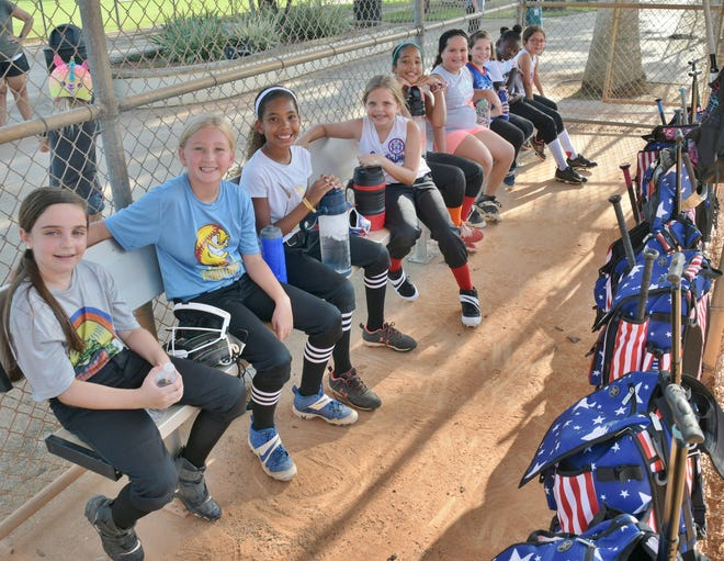 Members of the Royal Palm Beach 8-and-under all-star team pose in the dugout at Bob Marcello Baseball Complex following a recent  practice.