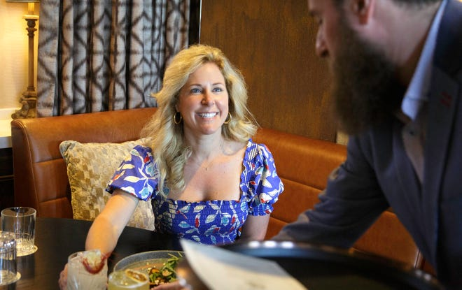 Flavor Palm Beach founder Briana Beaty samples dishes for this year's dining-deal promotion at The Ben Hotel's Proper Grit restaurant. Proper Grit's Joshua Solomon is pictured at right. Flavor Palm Beach kicks off Sept. 1 and runs through Sept. 30.