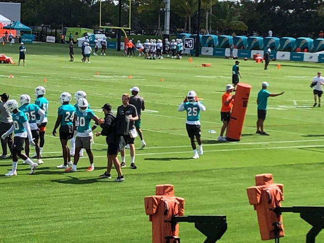 Unhappy cornerback Xavien Howard (25) is at the opening of Dolphins training camp.