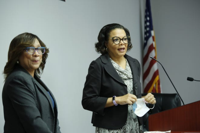 Dr. Maria Pitre-Martin (right) addresses the crowd of School Board Members and parents ahead of the ribbon-cutting ceremony of the new ESL center.