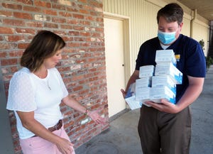 Timm Quinn, right, with the Greater Stockton Chamber of Commerce, gives 450 masks to Lincoln Center's Becky Loiacono last year.