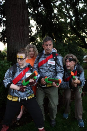 """Melanie Moser, from left, Kari Welch, Russell Dyball and Scott Frasier-Maskiell are armed and dangerous to ghosts in the Very Little Theatre's return to live theater with """"Minister's of Grace,"""" a Shakespearean """"Ghostbusters"""" parody."""