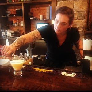 Heather Huntsinger puts the finishing touches on a popular drink called the Astro Pop.