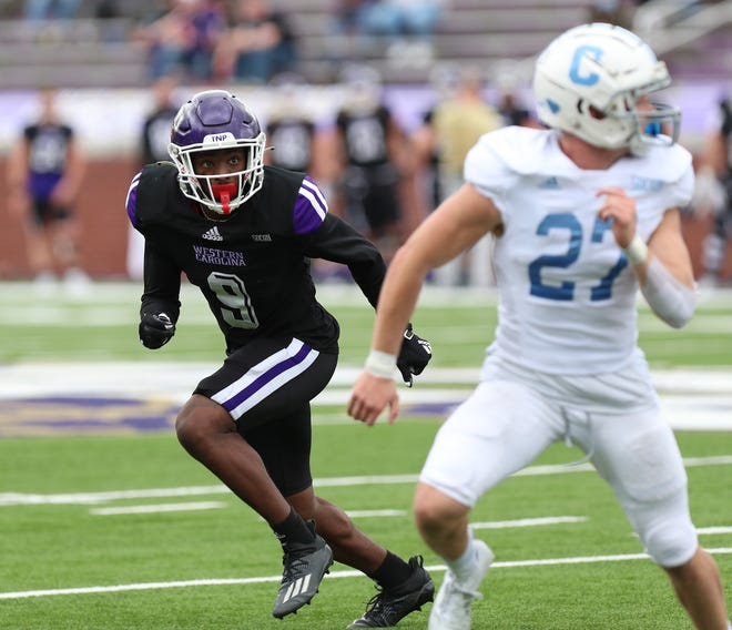 Former Western Carolina safety and Shelby High School graduate Dorian Davis, left, eyes a receiver against The Citadel on March 13, 2021.