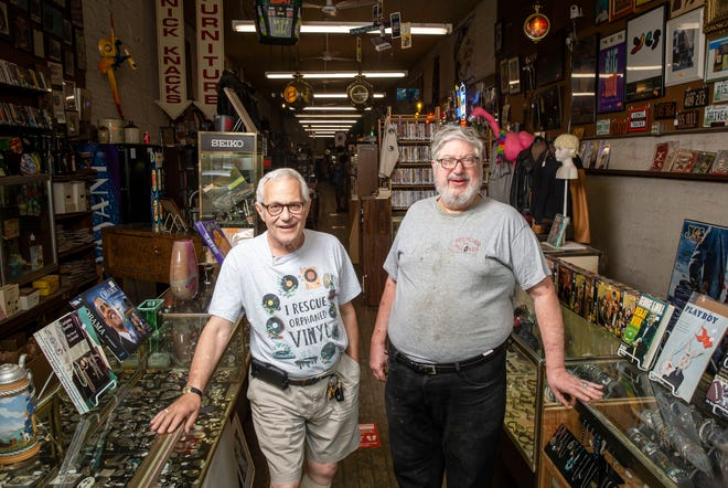 Mark Kessler, left, and his brother Gary Kessler, the owners of Recycled Records, have decided to retire and are looking for a buyer for the store that was originally a furniture store started by their grandparents and grew to become a downtown Springfield stable with vinyl records, CDs, cassette tapes, jewelry, musical instruments, posters and books.