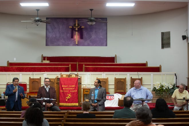 Topeka's mayoral candidates, from left, Mike Padilla, Daniel Brown, Leo Cangiani, Patrick Klick and John Lauer, take turns answering questions at Tuesday night's forum hosted by the African-American Women's Voter Alliance.