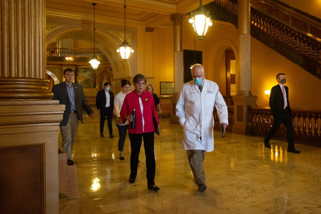 Gov. Laura Kelly walks with Lee Norman, secretary of Kansas Department of Health and Environment, to a press conference to give updates regarding the COVID-19 delta variant Wednesday at the Statehouse.