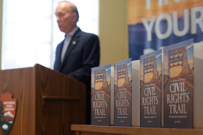 """Copies of """"The Official U.S. Civil Rights Trail: What Happened Here Changed the World,"""" a book authored by Lee Sentell, Alabama's tourism director, are laid on a table Tuesday at the Brown v. Board National Historic Site."""