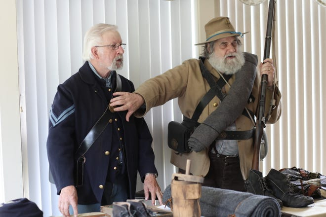 Members of the local chapter of the Sons of the Union Veterans of the Civil War joined Forbes Road Chapter of the Daughters of the American Revolution during the June 10 luncheon at the Somerset Country Club to share stories of their Civil War ancestors and demonstrate the similarities and differences between the uniforms, equipment and tools used by both sides during the war.  Alan Pettitte of Jenners, (right) represented and re-enacted for the Southern side of the war, and Tim E. Bell of Husband,  (left) represented the North.
