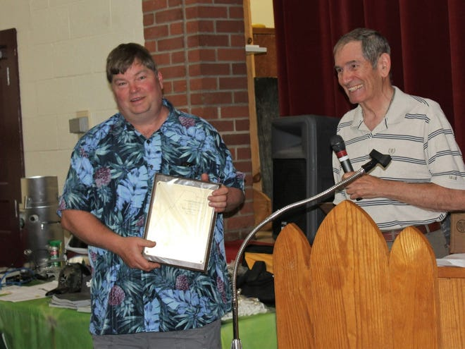 Joel Friedline (left), who died on Saturday as a result of a woods accident on his farm, accepts the Champion Syrup Award from Everett Sechler, president of the Somerset County Maple Producers Association, during the producers' banquet in June. Friedline often wore Hawaiian shirts and always had a knack for making others laugh. He operated Walnutdale Farms Maple with his wife, Mary, and parents, Lowell and Carna Friedline.