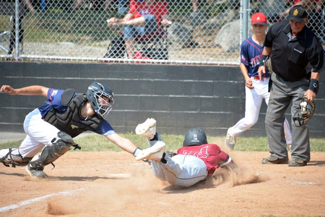 Frederick catcher Nick Grutzkuhn dives to tag out Funkstown's Dillon Smith at the plate to end the fifth inning. Smith was trying to score on a single to left but was gunned down by Tyler Prather. Frederick won the game 1-0 in 12 innings.