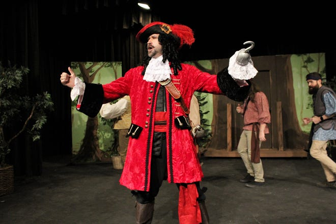 """Captain Hook (Nicolas Gooch) leads his pirate crew in a song and dance in this rehearsal scene from Abilene Community Theatre's """"Peter Pan,"""" which opens a two-weekend run Friday."""