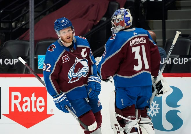 In this April 30, 2021, file photo, Colorado Avalanche left wing Gabriel Landeskog (92) skates past goaltender Philipp Grubauer during the first period of the team's NHL hockey game against the San Jose Sharks in Denver. Grubauer signed a six-year contract with the Seattle Kraken on Wednesday.