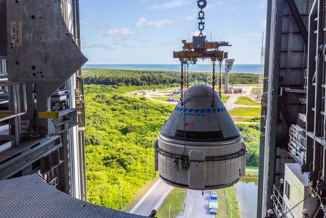 Boeing's Starliner capsule is mated to a United Launch Alliance Atlas V rocket at Cape Canaveral Space Force Station for the Orbital Flight Test-2 mission on Saturday, July 17, 2021.