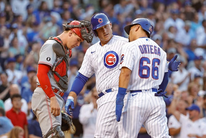 Jul 27, 2021; Chicago, Illinois, USA; Chicago Cubs first baseman Anthony Rizzo (44) celebrates with left fielder Rafael Ortega (66) after hitting a two-run home run against the Cincinnati Reds during the first inning at Wrigley Field. Mandatory Credit: Kamil Krzaczynski-USA TODAY Sports