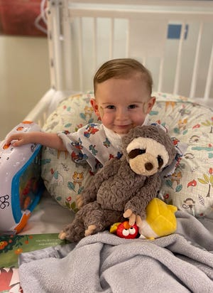 Oliver Nicholson holding his favorite sloth toy. After Oliver died in February 2021, his parents are petitioning the Cincinnati Zoo and Botanical Garden to name the newborn sloth in his honor.
