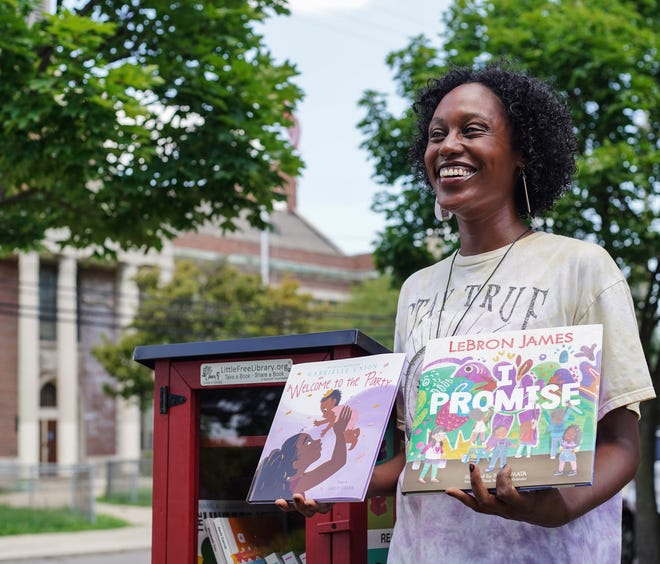 Lauren Gray, community engagement manager for Brilliant Detroit with the neighborhood's Little Library in Detroit on July 26, 2021. The Little Library is part of the Read in Color project that places books by and about people of color in little libraries throughout Detroit.