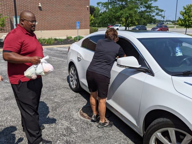 Anthony Walker, college and career readiness assistant director, spent the day Wednesday passing out meals to local families with Fremont City Schools kitchen staff.