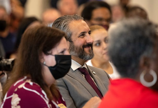 Lee County Schools Superintendent Ken Savage smiles from the audience during the ribbon cutting ceremony at Lehigh Acres Middle School on Wednesday, July 28, 2021, in Lehigh Acres.