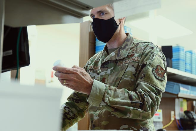 Maj. Landon Hatfield, 341st Healthcare Operations Squadron pharmacist, performs a quality control check on  July 14 at Malmstrom Air Force Base, Mont.