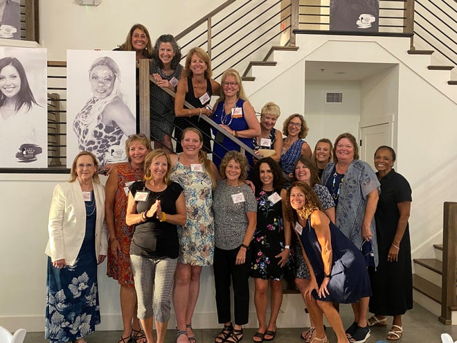 Attendees and honorees at the YWCA Greater Lafayette's 47th Annual Salute to Women banquet gather for a group photo, July 27, 2021.