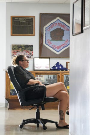 Trustee Jennifer Teising sits in a chair outside the room where the Wabash Township board is meeting, Tuesday, July 27, 2021 in West Lafayette.