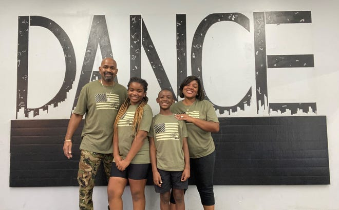 Quiana Revere - shown here with her husband Mark, daughter Amyah and son Marquis - found Marion to be a welcoming, supportive community for her family and her business.