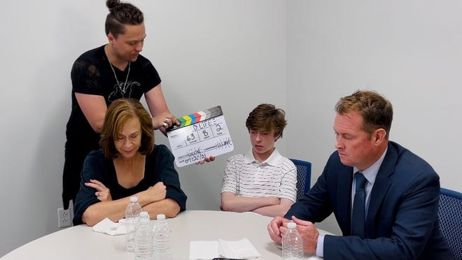 """A scene of """"Wild Life"""" was filmed at the Oconomowoc Police Department. Pictured from left, Rebecca Richards, Elijah Dercks, Thatcher Jacobs and Michael Oilar."""